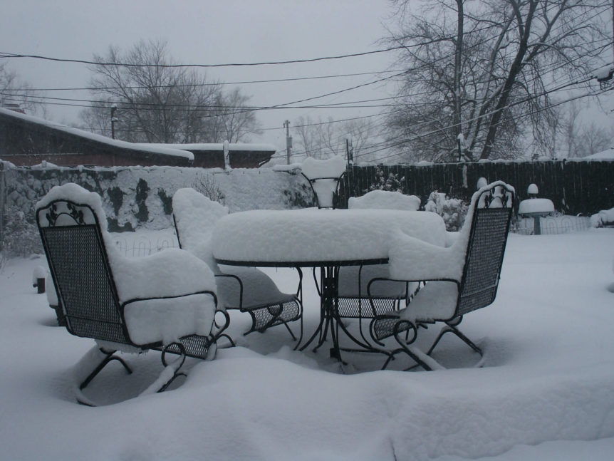 Some outdoor furniture that needs care because they've been snowed on