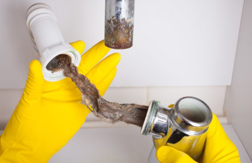 unclogging drain without drano